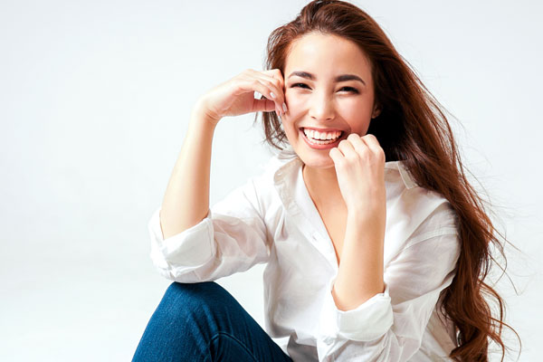 smiling-young-woman-on-white-background